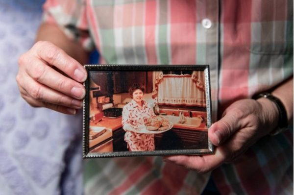 Marquardt holds an old photograph of herself of when she was married. Marquardt, a former truck driver who has high blood pressure and kidney disease, came out after raising three children.